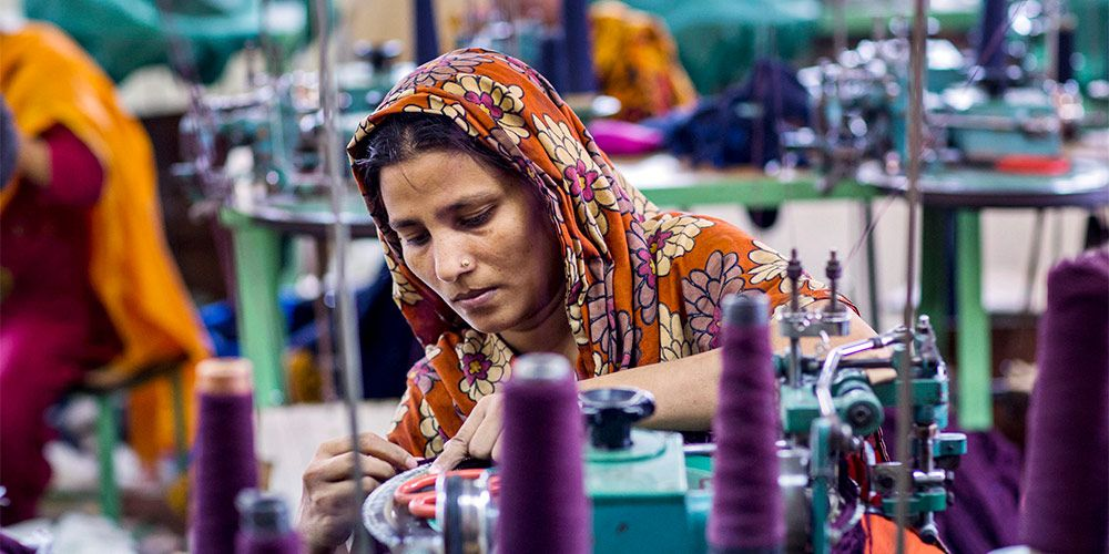 A lady working in a sewing factory