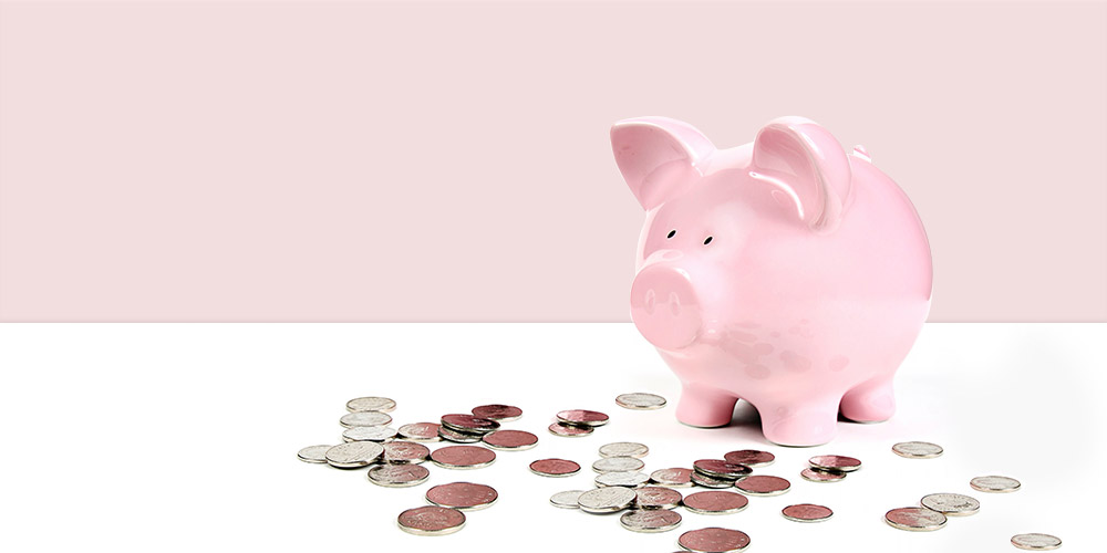 Pink 'piggy bank' surrounded by spare change - Rathbone Investment Management