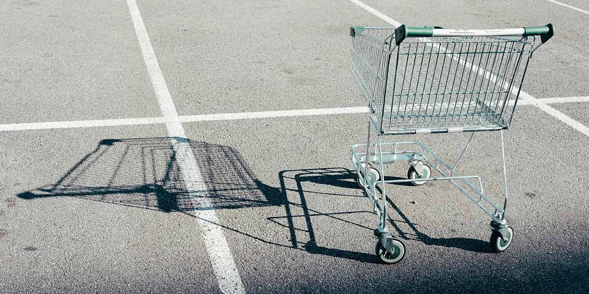 Abandoned shopping trolley in car park