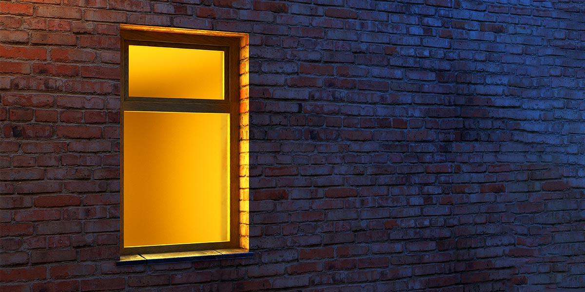 Lighted window at night