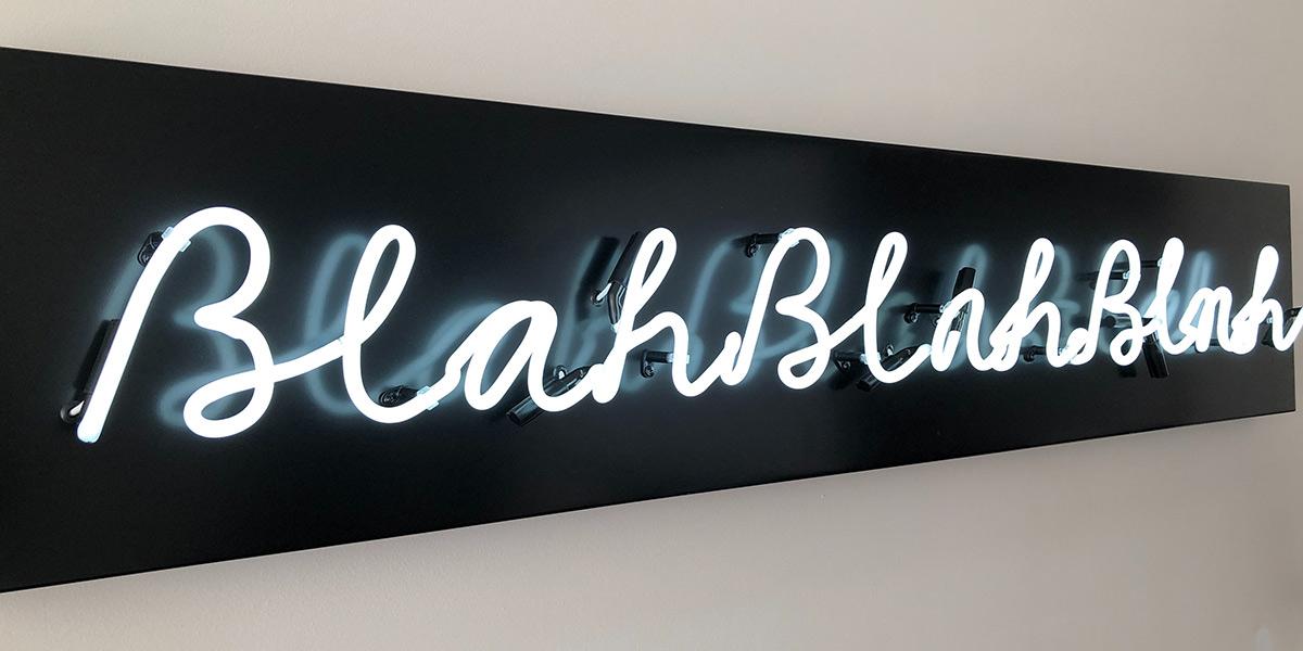 Blah blah blah light sign on wall