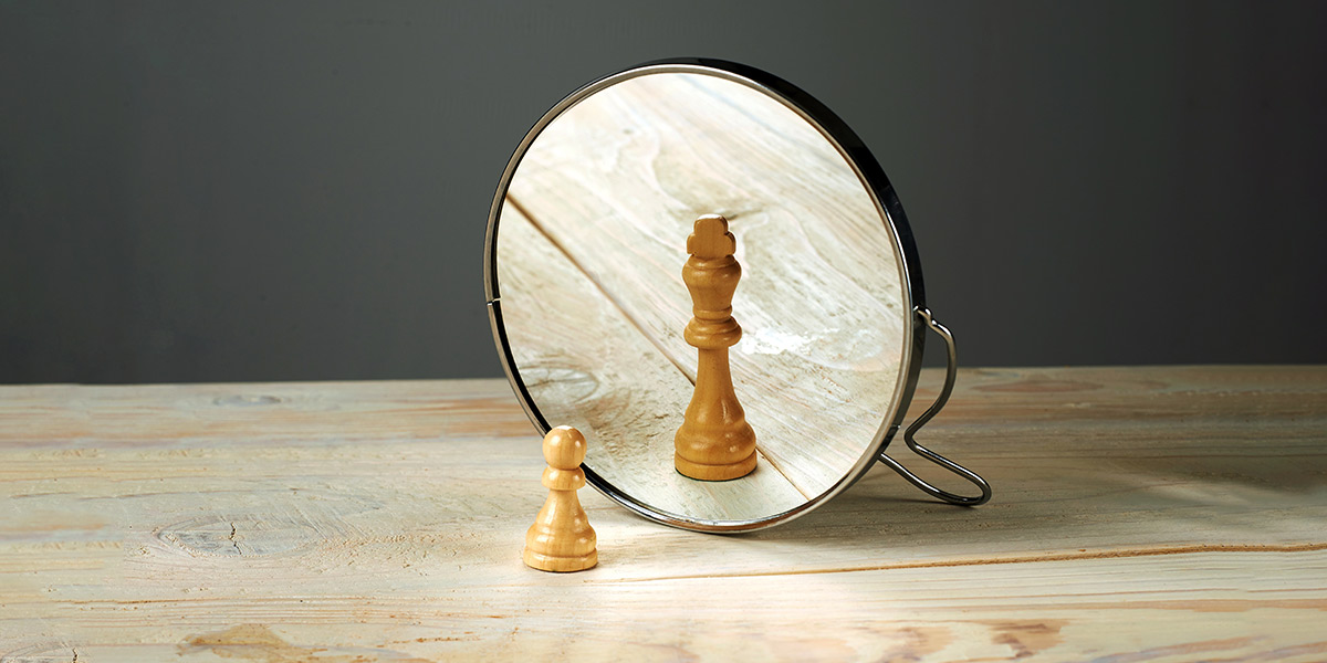 Chess piece looking in mirror