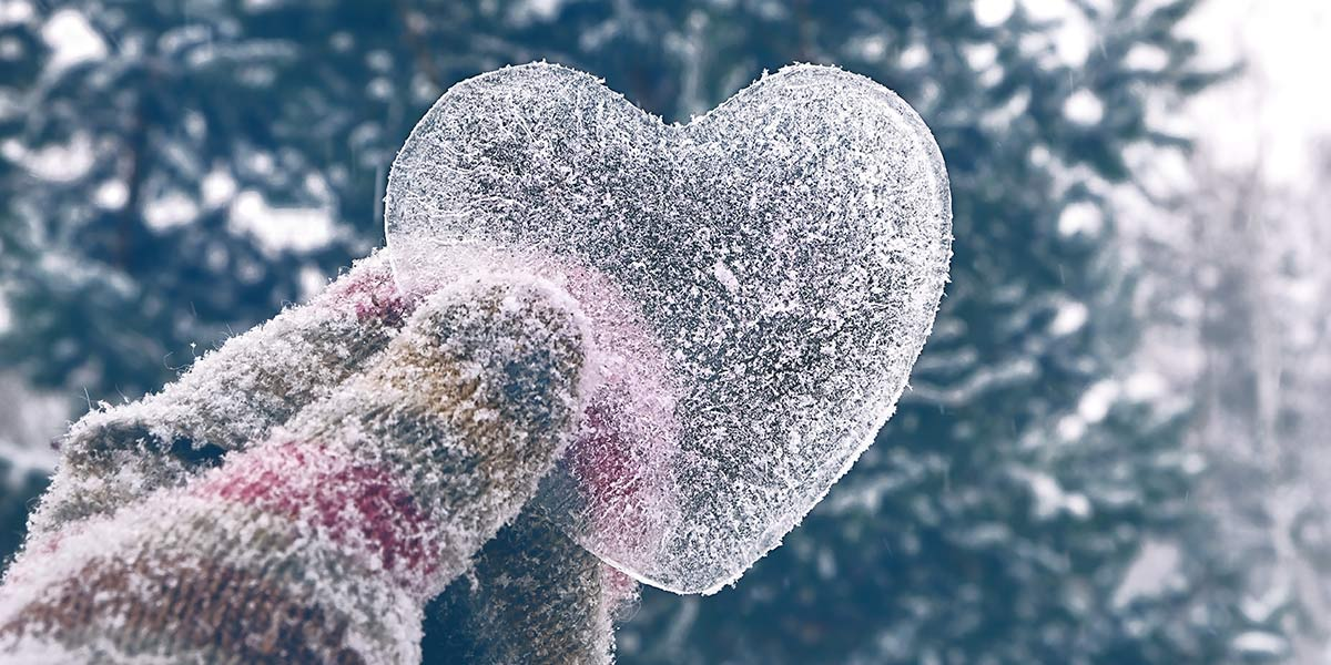 Hand holding up an ice heart