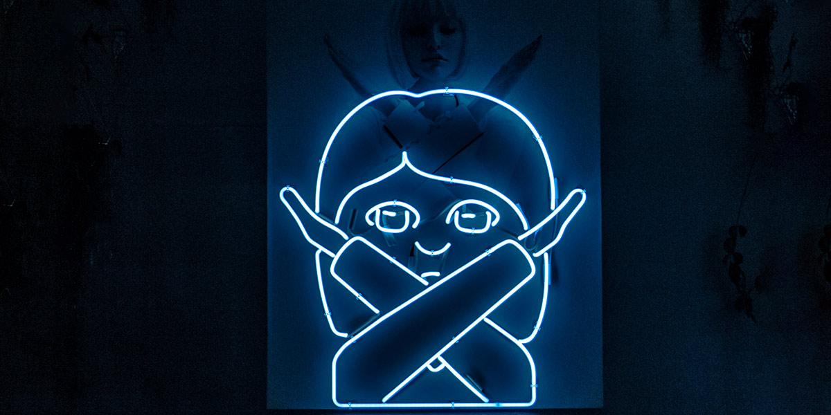 Illuminated emoji girl crossing arms