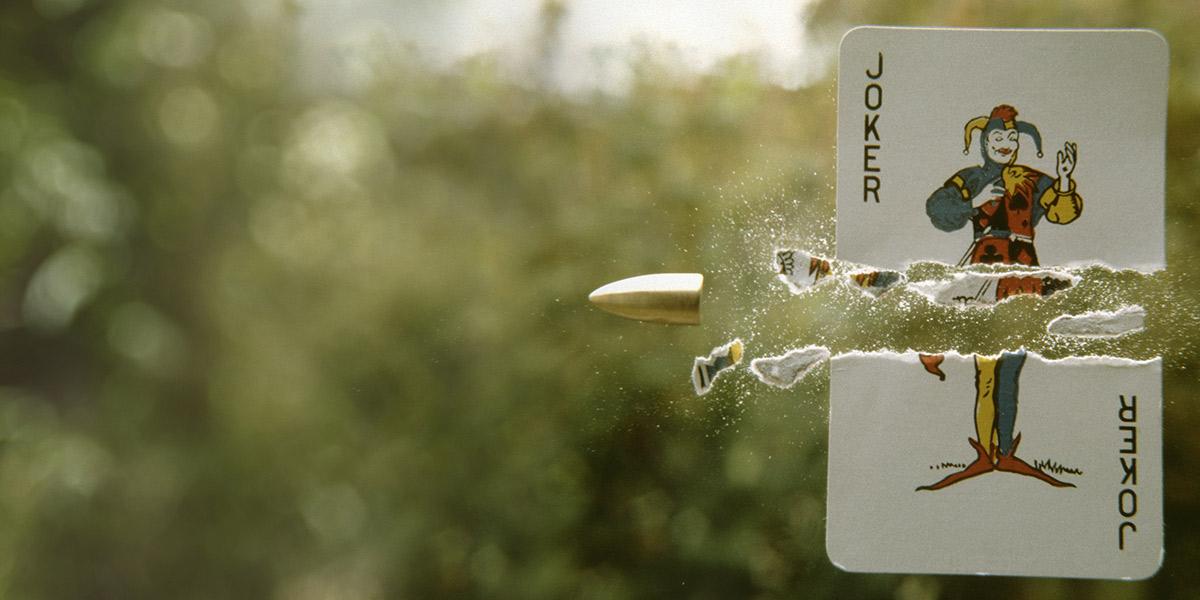 Joker card passing bullet