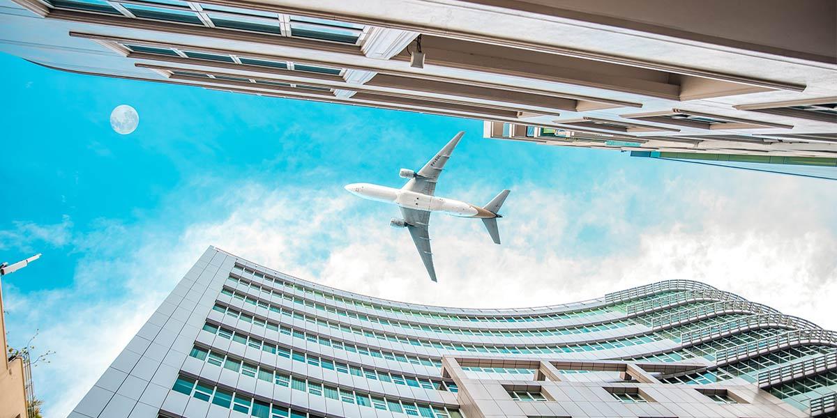 Plane above buildings
