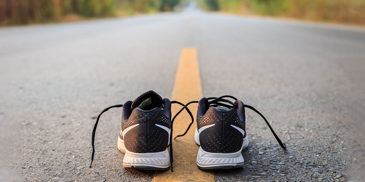 Running shoes in the middle of the road