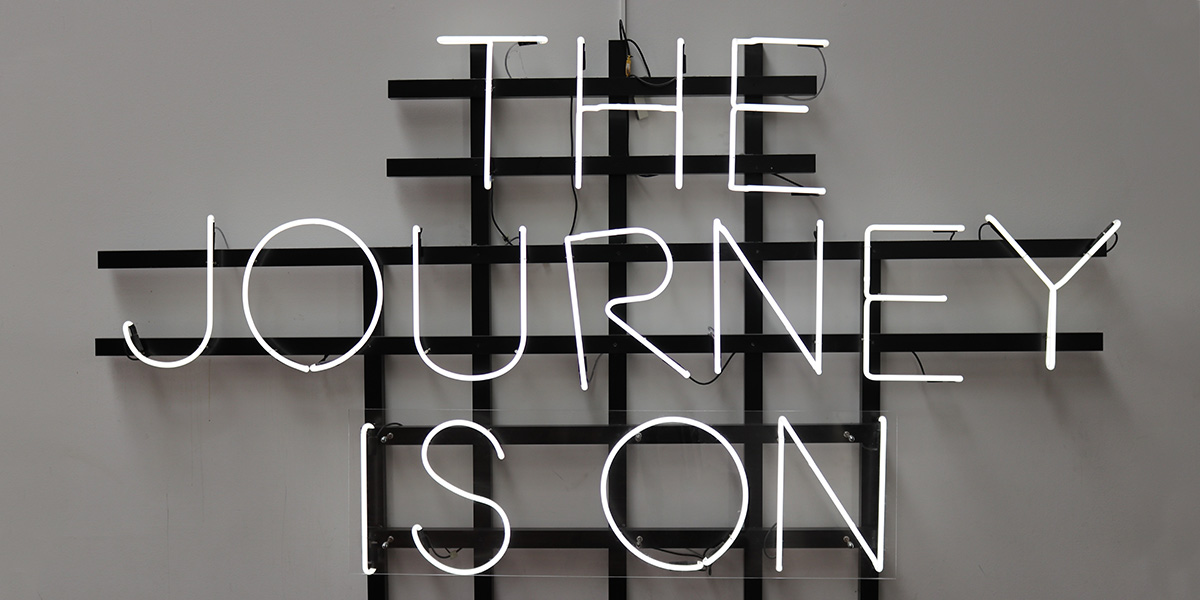 The journey is on light installation on the wall