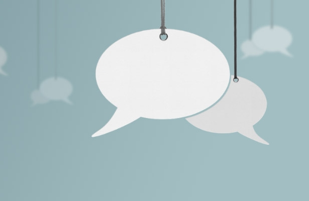 Speech bubbles hanging from strings - Rathbone Investment Management