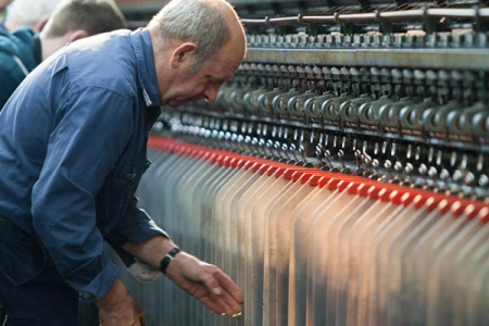 Man making textiles for Harris Tweed - Rathbone Investment Management
