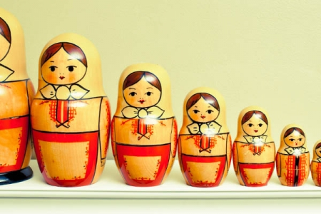 Russian Nesting dolls in a line, reducing in size towards the left - Rathbone Investment Management