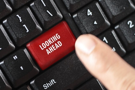 """A keyboard with a finger hovering over a red button stating """"looking ahead"""""""