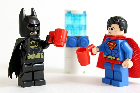 Batman and superman next to a water cooler