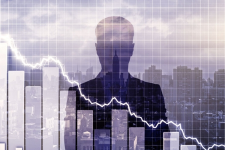 Image of a graph, in front of a city backdrop with the silhouette of a businessman