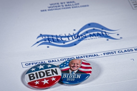 Biden badge on election mail envelope