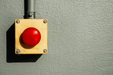Red button on grey wall