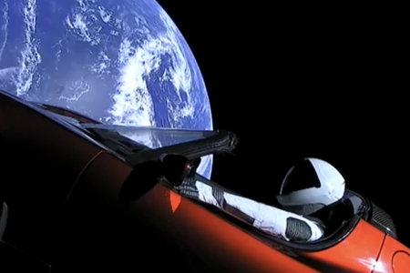 Spaceman with car in space