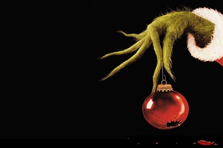 Grinch hand holding a bauble
