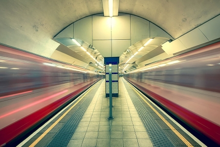 Tube station with trains passing